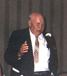 Joseph F. Schulte telling a story at his 50th wedding celebration - 1971