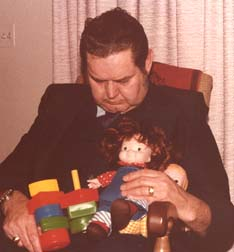 Papa Wally snoozing - toys from granddaughter Jill - April 1978
