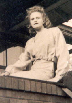 Rosie sitting on porch ledge in 1946 photo